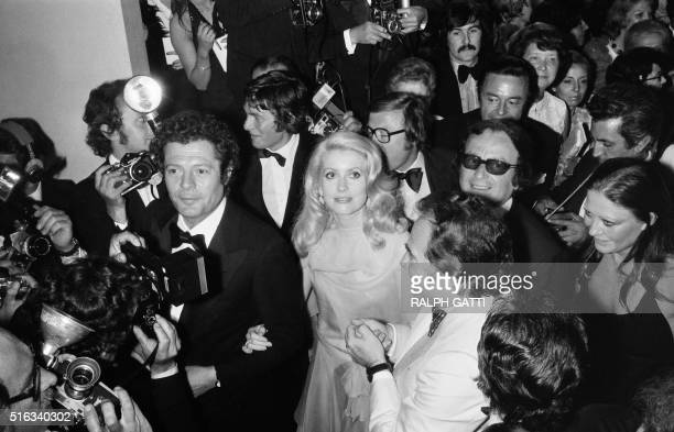 """Italian actor Marcello Mastroianni and his companion French actress Catherine Deneuve are pictured after the screening of the film """"La grande bouffe""""..."""