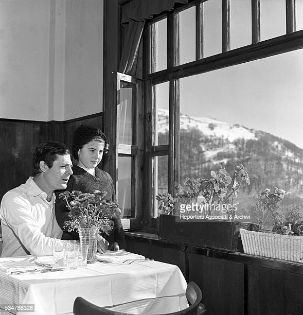 Italian actor Marcello Mastroianni and his daughter Barbara looking out of the window during their holiday in a village on the Mount Terminillo Italy...