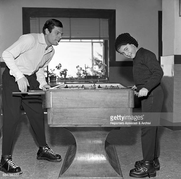 Italian actor Marcello Mastroianni and his daughter Barbara playing table football during their holiday in a village on the Mount Terminillo. Italy,...