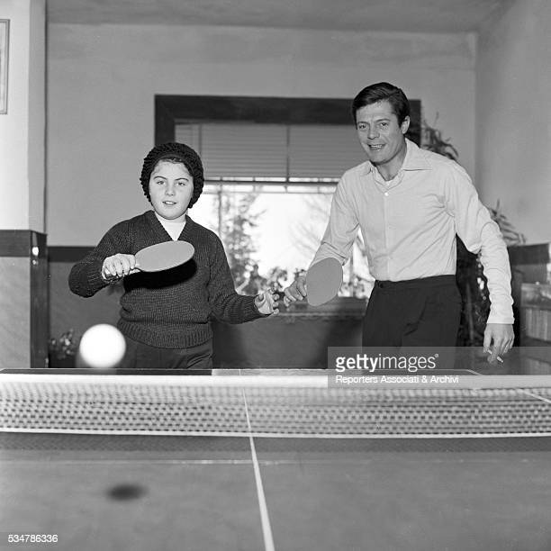 Italian actor Marcello Mastroianni and his daughter Barbara playing table tennis during their holiday in a village on the Mount Terminillo Italy 28th...