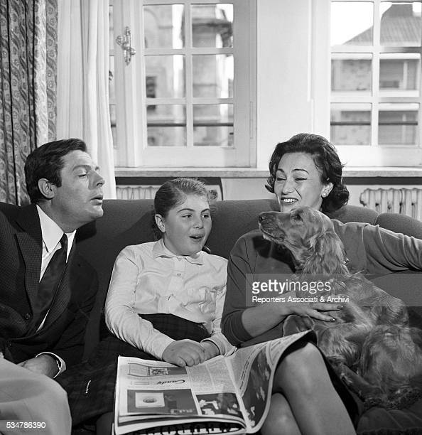 Italian actor Marcello Mastroianni and his wife Flora Carabella with their daughter Barbara at home 4th February 1962