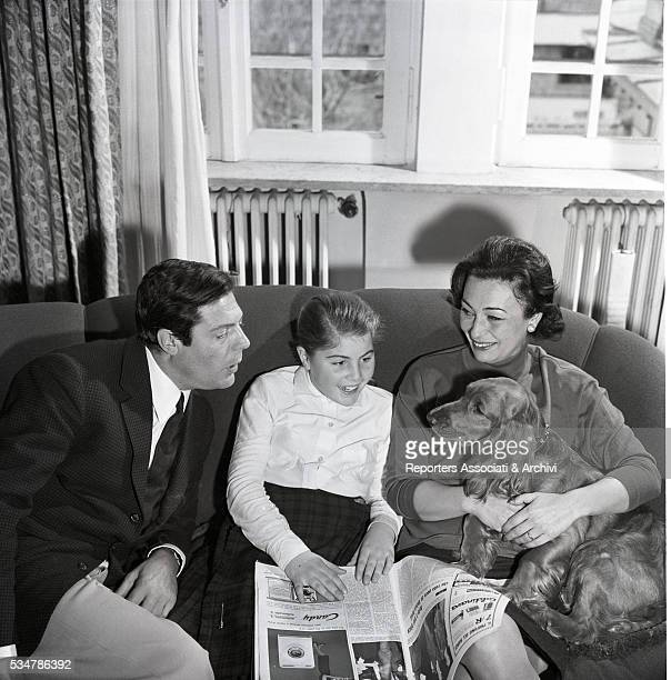 Italian actor Marcello Mastroianni and his wife Flora Carabella with their daughter Barbara at home. 4th February 1962