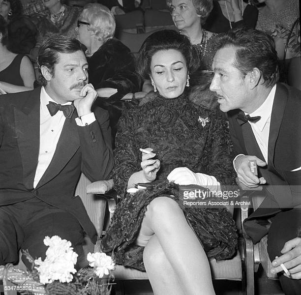 Italian actor Marcello Mastroianni attending the premiere of a film with his wife Flora Carabella and Italian actor Ugo Tognazzi 1973