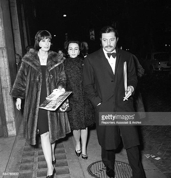 Italian actor Marcello Mastroianni attending the premiere of a film with his wife Flora Carabella 1973