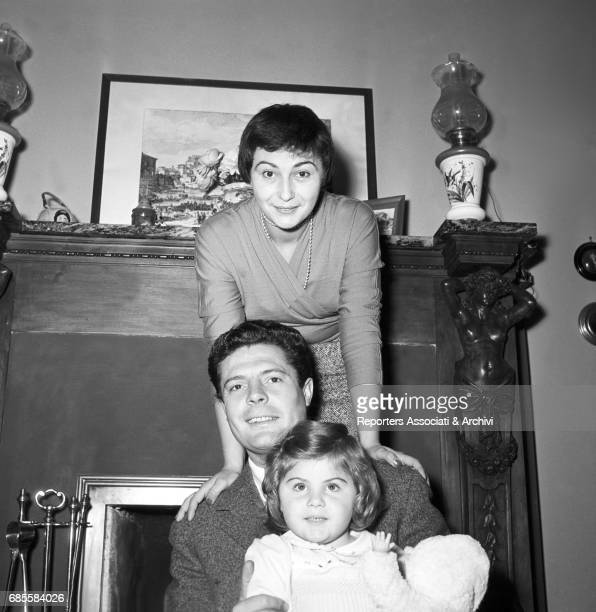 Italian actor Marcello Mastroianni , his wife and actress Flora Carabella and their daughter Barbara posing in their house for a photo shooting. 1955