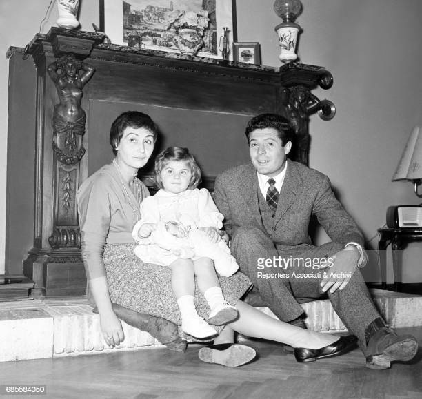 Italian actor Marcello Mastroianni his wife and actress Flora Carabella and their daughter Barbara posing in their house for a photo shooting 1955