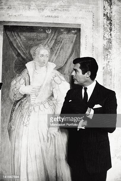 Italian actor Marcello Mastroianni looking at a fresco by Gian Battista Zelotti in a room of the Villa Foscari La Malcontenta during a break in...