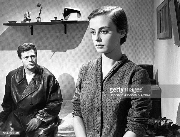 Italian actor Marcello Mastroianni looking at Italian actress Anna Maria Ferrero in the film Chronicle of Poor Lovers 1954