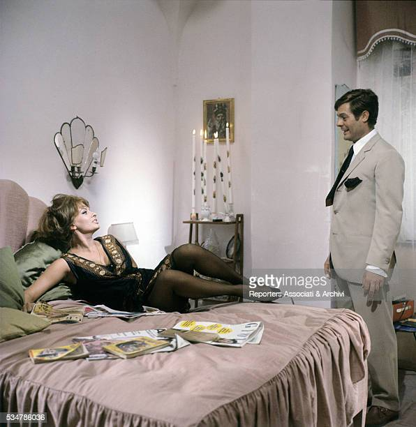 Italian actor Marcello Mastroianni looking at Italian actress Sophia Loren lying on a bed in the film Yesterday Today and Tomorrow segment Mara 1963