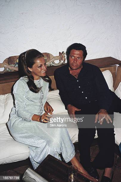 Italian actor Marcello Mastroianni sitting beside a woman in Costa Smeralda Sardinia Italy in August 1968