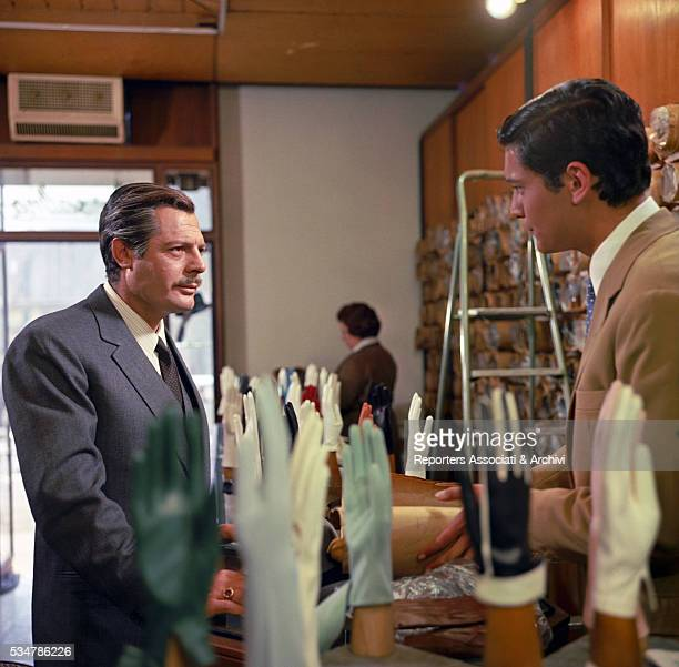 Italian actor Marcello Mastroianni talking to a shop assistant in the film Marriage Italian Style 1964