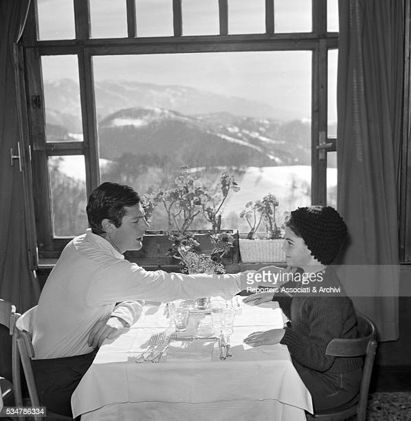 Italian actor Marcello Mastroianni touching his daughter Barbara's chin during their holiday in a village on the Mount Terminillo Italy 28th January...
