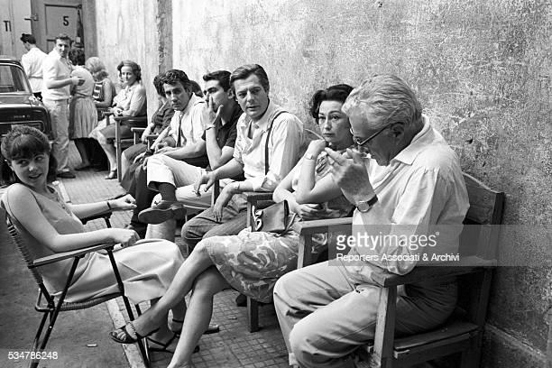 Italian actor Marcello Mastroianni with his wife Flora Carabella and Italian director Vittorio De Sica on the set of the film Marriage Italian Style...