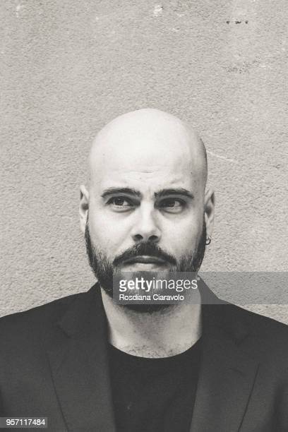 Italian actor Marco D'Amore poses on May 10, 2018 in Milan, Italy.