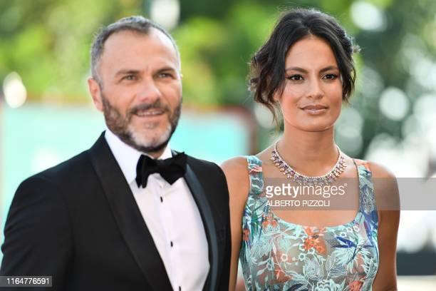 """Italian actor Massimiliano Gallo and his companion Brazilian actress Shalana Santana arrive for the screening of the film """"Il Sindaco del Rione..."""