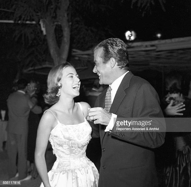 Italian actor Massimo Serato and Italian actress Anna Maria Ferrero dancing during a party at the Belvedere delle Rose Rome 25th August 1955