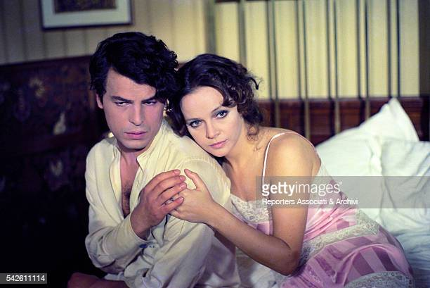 Italian actor Michele Placido and Italian actress Laura Antonelli in a bedroom in The Divine Nymph 1975