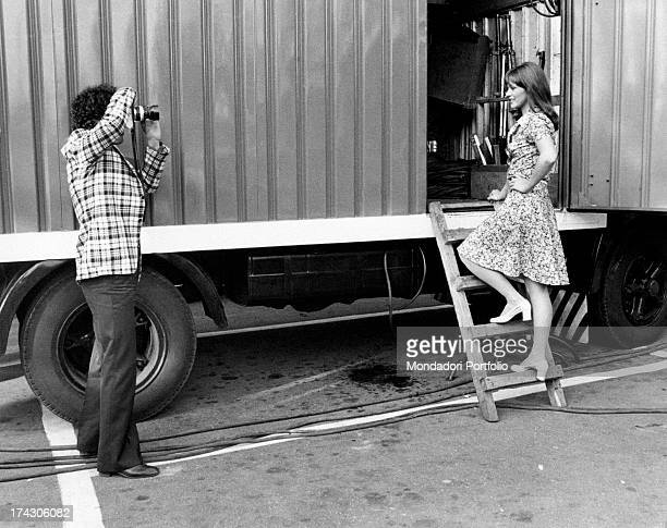 Italian actor Ninetto Davoli taking a photograph of Italian actress Agostina Belli Rome 1970s