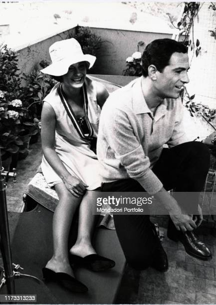 Italian actor Nino Manfredi and Italian actress Anna Maria Ferrero smiling on the set of the film Countersex Italy 1964