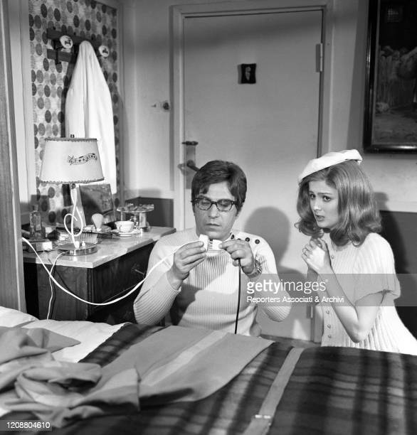Italian actor Nino Manfredi branching a socket beside American actress Pamela Tiffin in the film Kill Me with Kisses. 1968