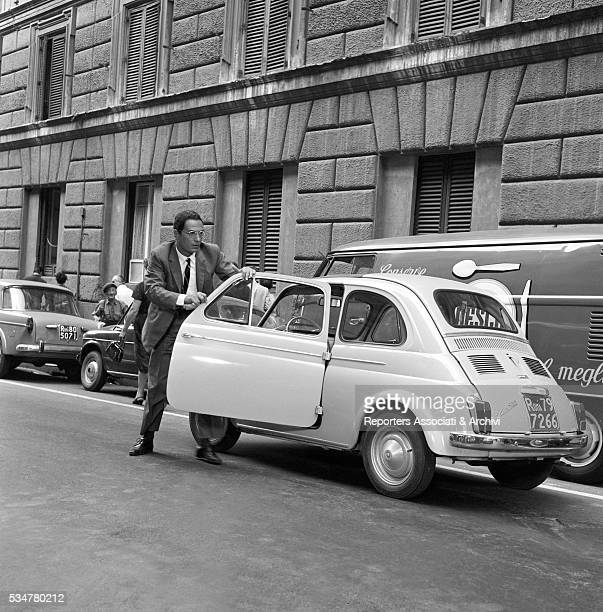 Italian actor Nino Manfredi driving a Fiat 500 in Made in Italy Italy 1965