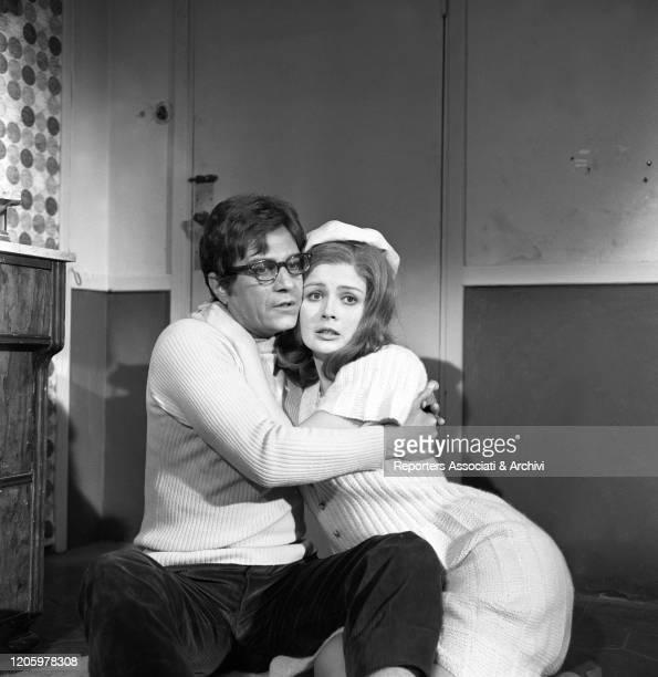 Italian actor Nino Manfredi hugging American actress Pamela Tiffin in the film Kill Me with Kisses. 1968