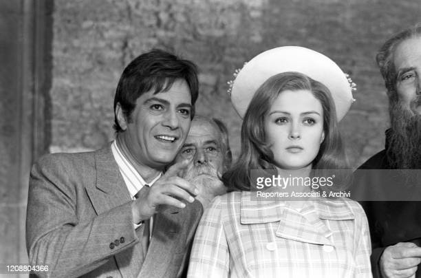 Italian actor Nino Manfredi pointing at something far beside American actress Pamela Tiffin in the film Kill Me with Kisses. 1968