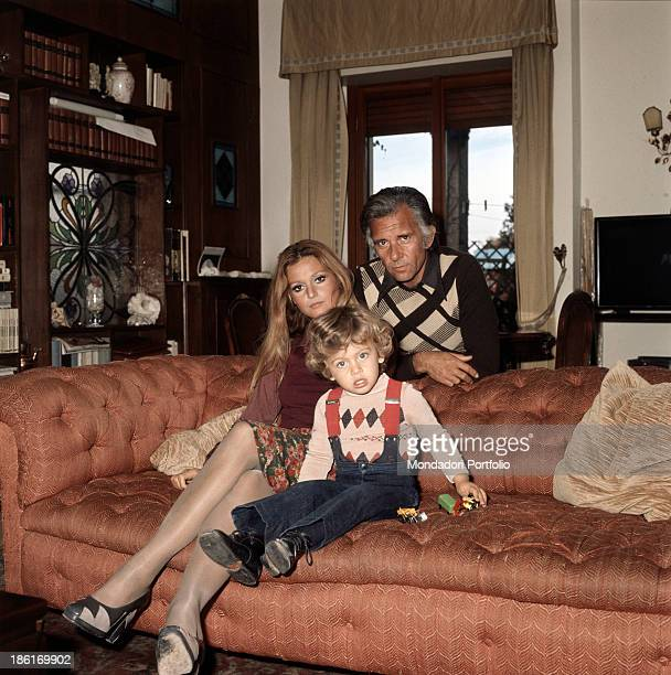 Italian actor Paolo Ferrari and Italian actress Laura Tavanti posing sitting on a sofa with their son Stefano 1974