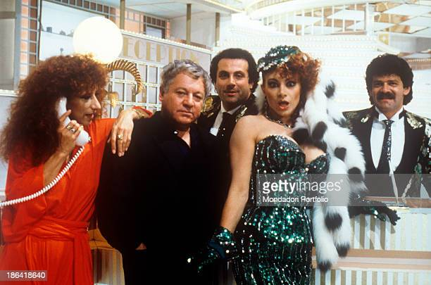 Italian actor Paolo Villaggio poses with he cast that hosts the variety show Grand Hotel by Italian director Giancarlo Nicotra and broadcasted by...