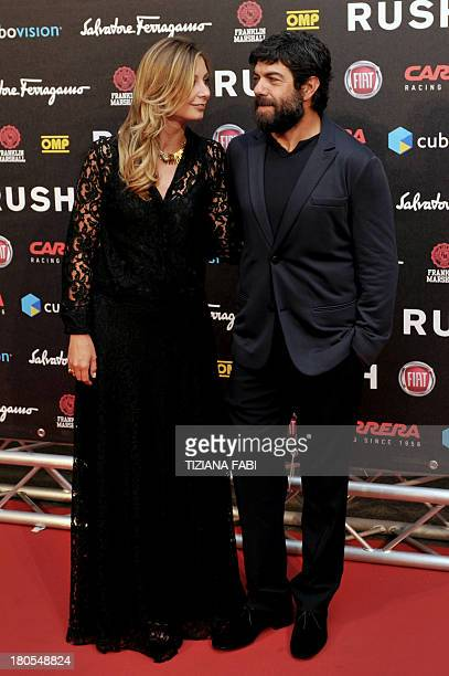 Italian actor Pierfrancesco Favino and his wife Anna Ferzetti attend the premiere of the film Rush on September 14 2013 in Rome AFP PHOTO / TIZIANA...