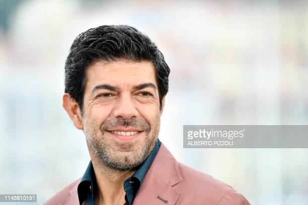 Italian actor Pierfrancesco Favino poses during a photocall for the film The Traitor at the 72nd edition of the Cannes Film Festival in Cannes...