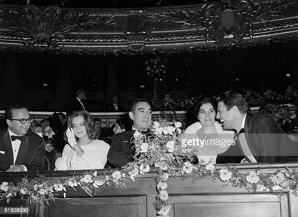 Italian actor Raf Vallone chats with US actor Anthony Quinn accompanied by French actress Romy Schneider during the premiere of the film 'The...