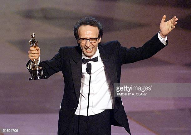 """Italian actor Robero Benigni holds his Oscar after winning the Best Performance by an Actor in a Leading Role for his part in the movie """"Life is..."""