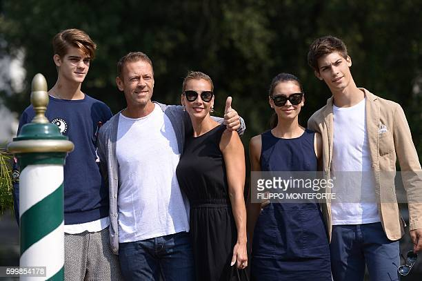 Italian actor Rocco Siffedri and his wife Rosa Caracciolo leave the Excelsior Hotel with Leonardo Tano Laura Medcalf and Lorenzo Tano during at the...