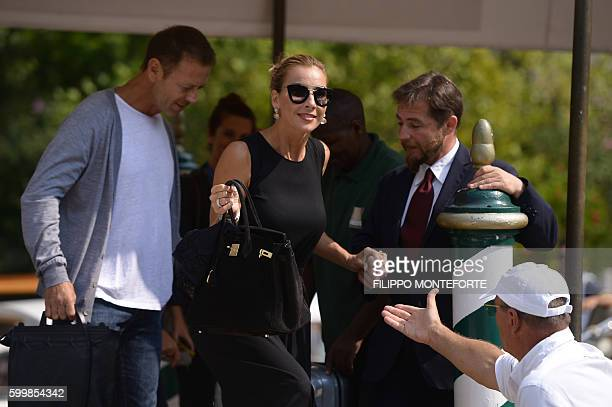 Italian actor Rocco Siffedri and his wife Rosa Caracciolo leave the Excelsior Hotel during at the 73rd Venice Film Festival on September 7, 2016 at...