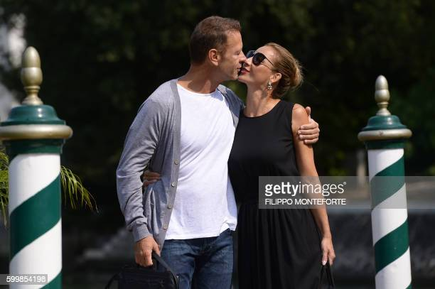 Italian actor Rocco Siffedri kisses his wife Rosa Caracciolo as they leave the Excelsior Hotel during at the 73rd Venice Film Festival on September 7...