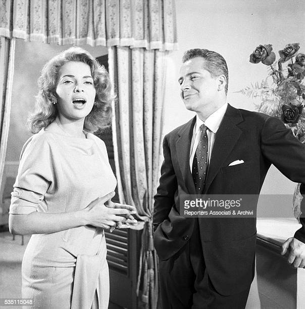 Italian actor Rossano Brazzi and American singer and actress Abbe Lane on the set of the American TV movie In giro per il mondo 1956