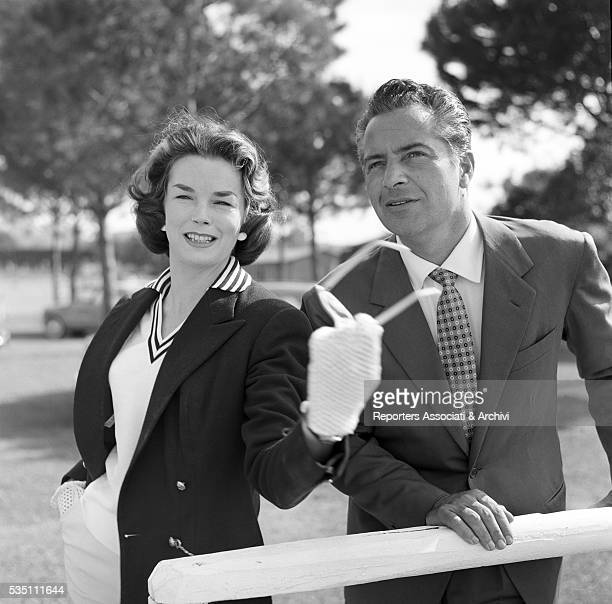 Italian actor Rossano Brazzi and British actress Dawn Addams attending a match of polo Rome 1957