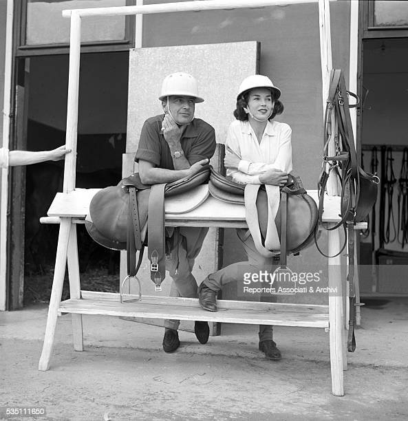 Italian actor Rossano Brazzi and British actress Dawn Addams waiting to play a match of polo Rome 1957