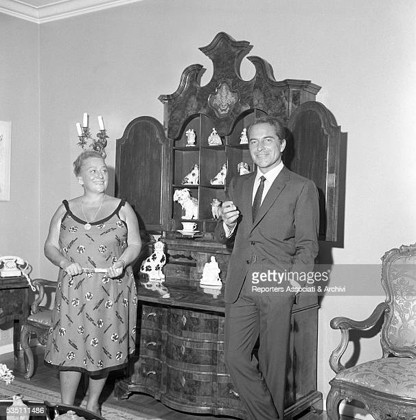 Italian actor Rossano Brazzi and his wife Lidia Bertolini posing in the living room at home 21st August 1965
