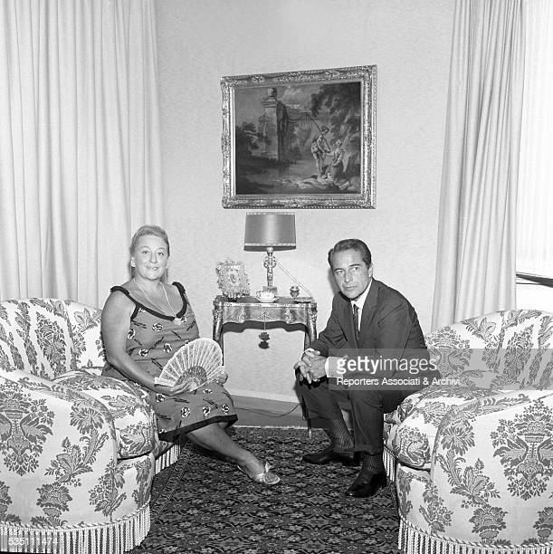 Italian actor Rossano Brazzi and his wife Lidia Bertolini sitting in the living room at home 21st August 1965