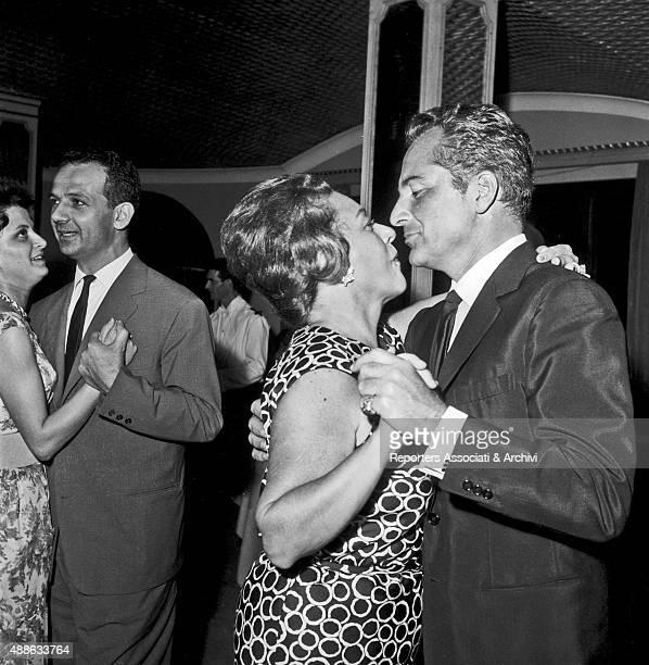 Italian actor Rossano Brazzi dancing with his wife and Italian baroness Lidia Bertolini at a party held in a villa in Grottaferrata Roman Castels...