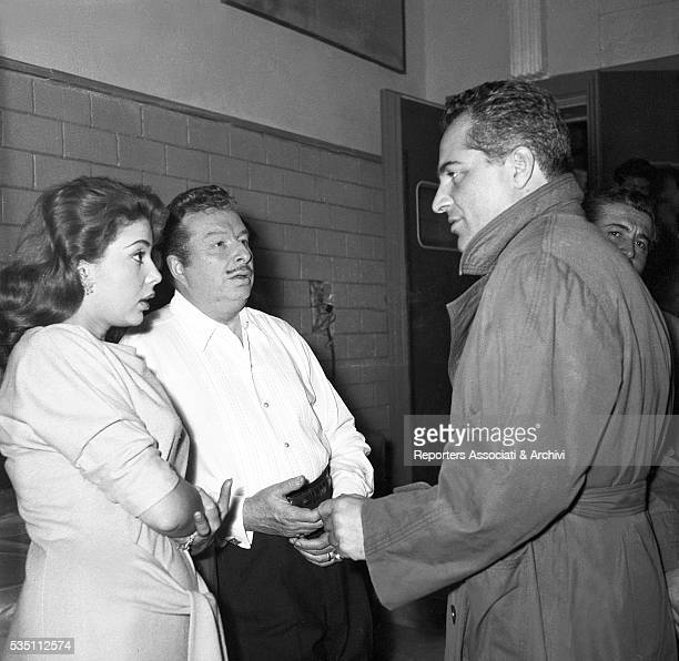 Italian actor Rossano Brazzi talking to American singer and actress Abbe Lane and to Spanish musician and conductor Xavier Cugat on the set of the...