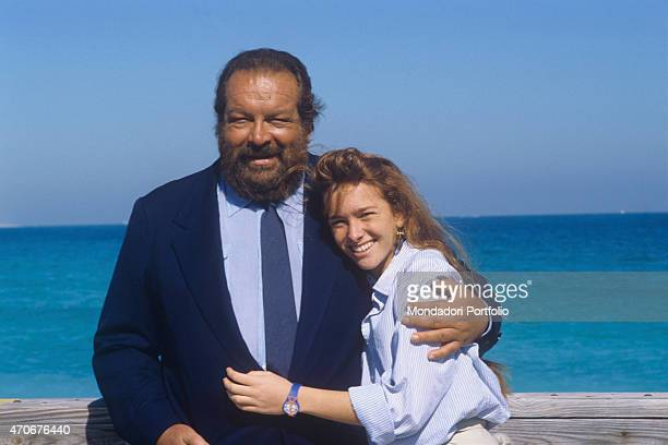 Italian actor scriptwriter and film producer Bud Spencer and his daughter Italian actress Diamante posing smiling on the seashore 1987