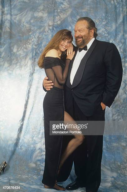 """""""Italian actor, scriptwriter and film producer Bud Spencer posing smiling with American actress and model Carol Alt. 1990 """""""