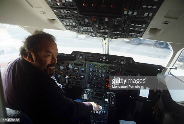 Italian actor scriptwriter and film producer Bud Spencer sitting in the flight deck of an aeroplane 1988