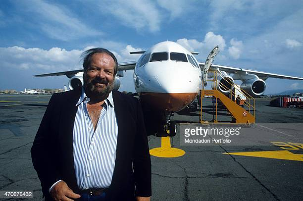 Italian actor scriptwriter and film producer Bud Spencer smiling near an aeroplane 1988