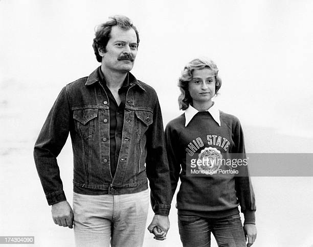 Italian actor Sergio Fantoni in casual clothes holds the hand of his daughter Monica born from his marriage with actress Valentina Fortunato Rome 1974