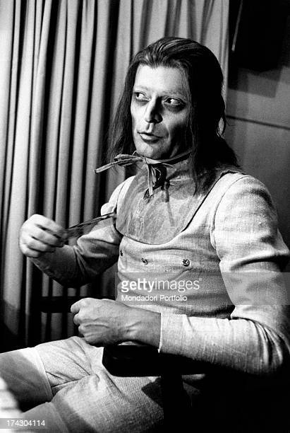 Italian actor Sergio Fantoni perfects his stage costume as De Flores before the recital of The Changeling directed by Luca Ronconi at the Teatro...