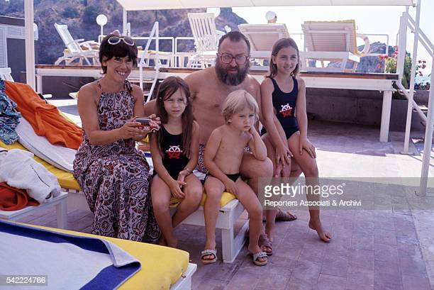 Italian actor Sergio Leone with his wife Carla and children Francesca Raffaella and Andrea in a swimming pool 1972
